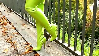 Blonde hot latex outfit with green boots