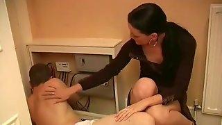 Clothed babe gives hot handjob